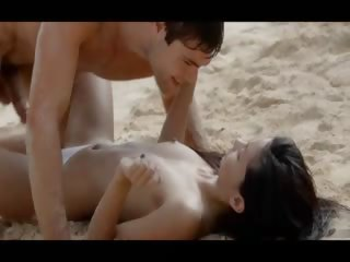 Extremely hot lovers caring on the seaside